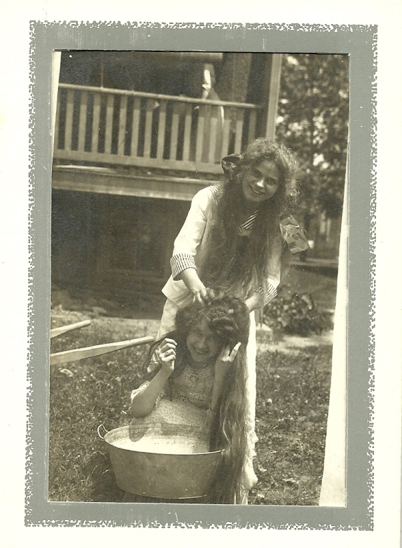 My grandmother getting her hair washed by a cousin. In the twenties she sold her beautiful long auburn hair for $50 - her family was outraged!